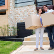 Happy couple moving house — Stock Photo #13495785