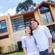 Stock Photo: Couple with beautiful house