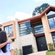 Stock Photo: Couple looking at house