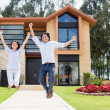 Excited couple about their house — Stock Photo #13495799