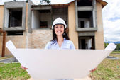 Architect holding blueprints — Stock Photo
