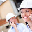 Architects talking on the phone — Stock Photo
