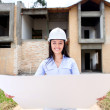 Woman looking at a house project — Stock Photo