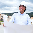 Thoughtful architect holding blueprints — Stock Photo #13594890