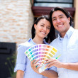 Couple painting their house - Stock Photo