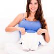 Woman with baby clothes - Stock Photo