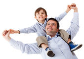 Father carrying his son — Stock Photo