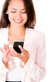 Business woman sending a text message — Stock Photo