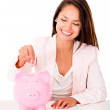 Stock Photo: Woman saving in a piggybank