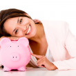 Stock Photo: Womwith her savings