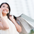 Shopping woman on the phone — Stock Photo #14154932