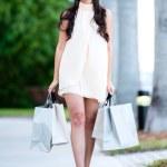 Female shopper walking on the street — Stock Photo