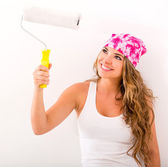 Woman holding a paint roller — Stock Photo