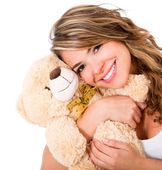 Cute woman with a teddy bear — Stock Photo
