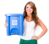 Woman holding a recycle bin — Stock Photo