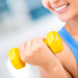Stock Photo: Fit womlifting weights