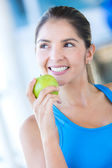 Woman weating an apple — Stock Photo