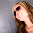 Thoughtful woman wearing sunglasses — Stock Photo #14848395