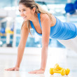 Gym womdoing push ups — Stock Photo #14882053