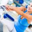 Athletic woman stretching — Stock Photo #14882055