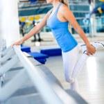 Gym woman stretching her leg — Stock Photo
