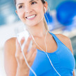 Gym woman listening to music — Stock Photo