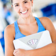 Happy woman holding weight scale — Stock Photo