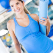 Royalty-Free Stock Photo: Woman with a yoga mat
