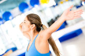 Excited gym woman loosing weight — Stock Photo