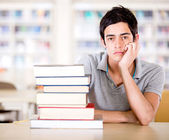 Bored student at the library — Stock Photo