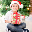 Happy boy with a Christmas gift — Stock Photo #15064427