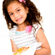 Little girl eating pizza — Stock Photo