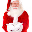 Santa Claus holding something — Stock Photo #15064519