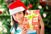 Happy girl with a Christmas gift — Stock Photo