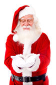 Santa Claus holding something — Stock Photo