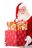 Happy Santa with Christmas gifts — Stock Photo