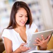 Woman reading on a tablet computer - Stock Photo