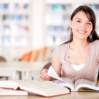 Happy female reader - Stock Photo