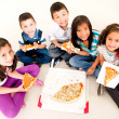 Stock Photo: Group of kids eating pizza