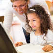 Stock Photo: Girl learning to use technology