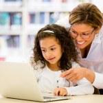 Schoolgirl researching online — Stock Photo