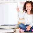 Little girl at the library — Stock Photo