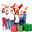 Santa giving Christmas gifts — Stock Photo #15659597