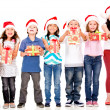 Kids holding Christmas gifts — Stock Photo
