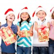 Kids with Christmas presents — Stock Photo #15659607