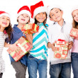 Children with Christmas presents — Stockfoto