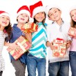 Children with Christmas presents — Foto de Stock