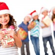 Christmas girl with a gift — Stock Photo #15659615