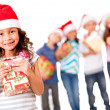 Christmas girl with a gift  — Stock Photo
