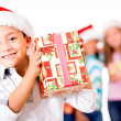 Happy boy with a Christmas gift — Stock Photo